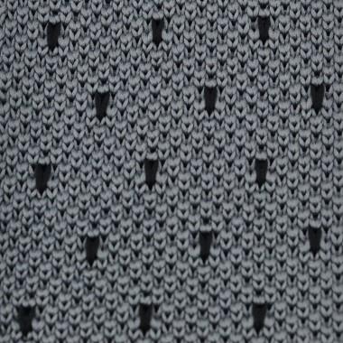 Cravate tricot pour homme. Gris à pois noirs.